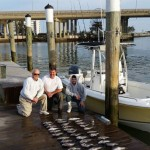 Dockhand Charlie With His Crew Pose With Their Haul